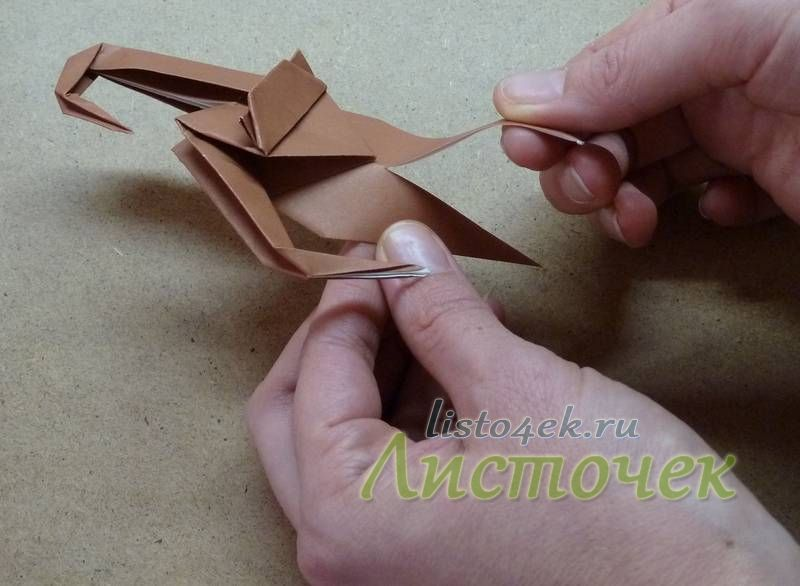 Разрезаем нижний треугольник до начала мордочки
